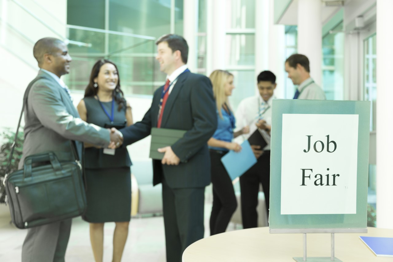 Job fair with people meeting one another